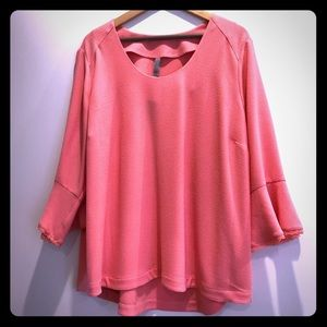 Melissa McCarthy Seven top with bell sleeves.